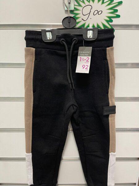 Sporta bikses 18-24 mēn./92cm/Melnas ar gaiši brūnām un baltu svītru sānos.