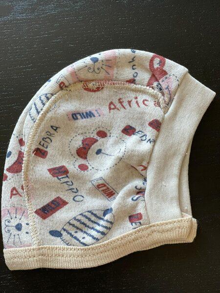 Zīdaiņu cepurīte/sienama/Bēša uzrakstiem Africa u.c./Turcija